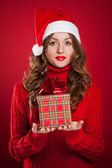 Beautiful girl holding Christmas present — Stock Photo
