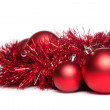 Two christmas tree toys with red garland — Stock Photo