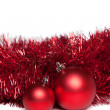 Two christmas tree toys with red garland — Stock Photo #35803449