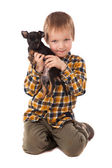 Smiling little boy holding his puppy — Stock Photo