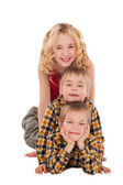 Three children playing on the floor with each other — Stock Photo