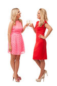 Beautiful girls in fashion dresses with champagne — Stock Photo
