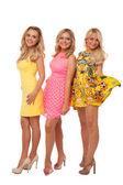 Three beautiful girls in fashion dresses — Stock Photo