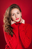 Beautiful brunette girl wearing red sweater  — Stock Photo