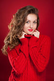 Beautiful brunette girl wearing red sweater  — Stockfoto