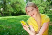 Girl with listening music — Stock Photo