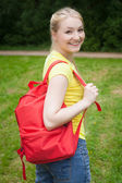 Girl with red rucksack — Stock Photo
