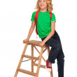 Little blonde girl in green t-shirt with red bag — Stock Photo