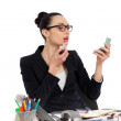 Brunette businesswoman putting on her make-up at work — Stock Photo #50018677