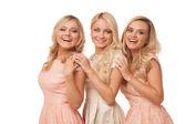 Three beautiful girls in fashion dresses isolated — Stock Photo