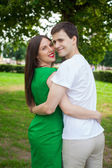 Love couple out in the park with — Stock Photo
