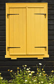 Colourful shuttered window — Stock Photo
