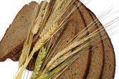 Ears of rye and sliced bread — Stock Photo
