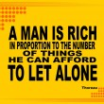 Постер, плакат: A Man is Rich motivational phrase
