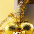 Golden Christmas baubles and a gift — Stock Photo
