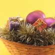 Christmas basket on yellow background — Stock Photo