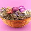 Decorative Christmas basket on pink background — Stock Photo