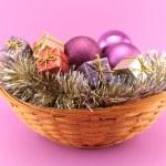 Decorative Christmas basket on pink background — Stock Photo