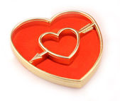 Golden heart cupido arrow — Stock Photo