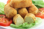 Potato croquettes and tomatoes — Stock Photo