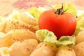 Baby potatoes with tomato — Stock Photo