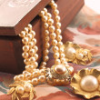 Decorated box and pearl necklace — Stock Photo #48699233