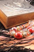 Silver box and red necklace closeup — Stock Photo