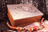 Silver box and red necklace — Stock Photo