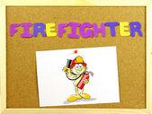 Written word FIREFIGHTER in a corkboard — Stock Photo