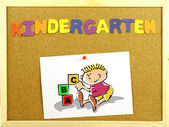 Kindergarten word on a corkboard — Stock Photo