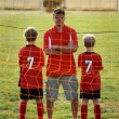 Soccer Coach and Sons — Stock Photo #19895797