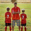 Stock Photo: Soccer Coach and Sons