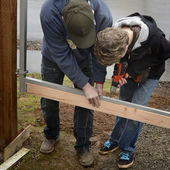 Father and Son Building a Gate — Stock Photo