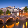 Amsterdam tranquil canal scene, Holland — Stock Photo #26067695