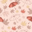 Seamless background pattern of autumn leaves and umbrellas. — Stock Vector