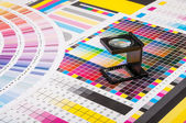 Magnifier and test print — Stock Photo