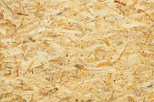 Background. Natural wooden pressed shavings — Stock Photo
