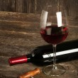 Stock Photo: Bottle of red wine and glass