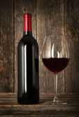 Bottle of red wine and glass — Stock Photo