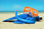 Mask and flippers on a beach — Stock Photo