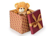 Teddy bear in a gift box on white background — Stock Photo
