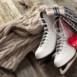 The white ice skates on old wooden boards — Stock Photo #40414179