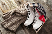 The white ice skates on old wooden boards — Stock Photo