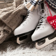 White ice skates on old wooden boards — Stock Photo #40721799