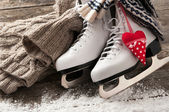 White ice skates on old wooden boards — Stock Photo