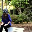 Nuclear war. Girl in gas mask sitting on the bench — Stock Video #19027435