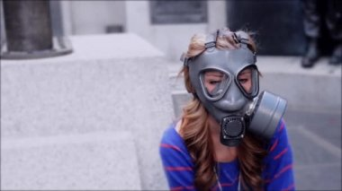 Pensive girl in gas masks — Stock Video