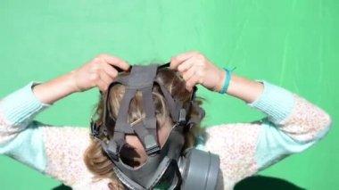 Nuclear war. Girl dress gas masks. green screen — Stock Video