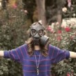 Girl in gas masks around the rose — Stock Video #19030907