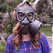 Girl in gas masks around the rose — Stock Video #19031537